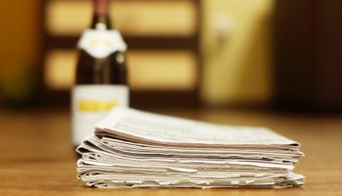 newspapers and wine bottle - g3 press releases